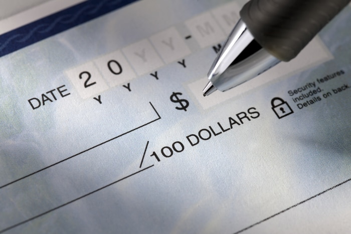 close up shot of check writing