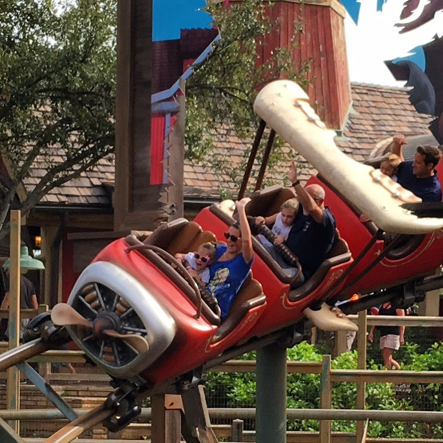 barnstormer in Magic Kingdom with family