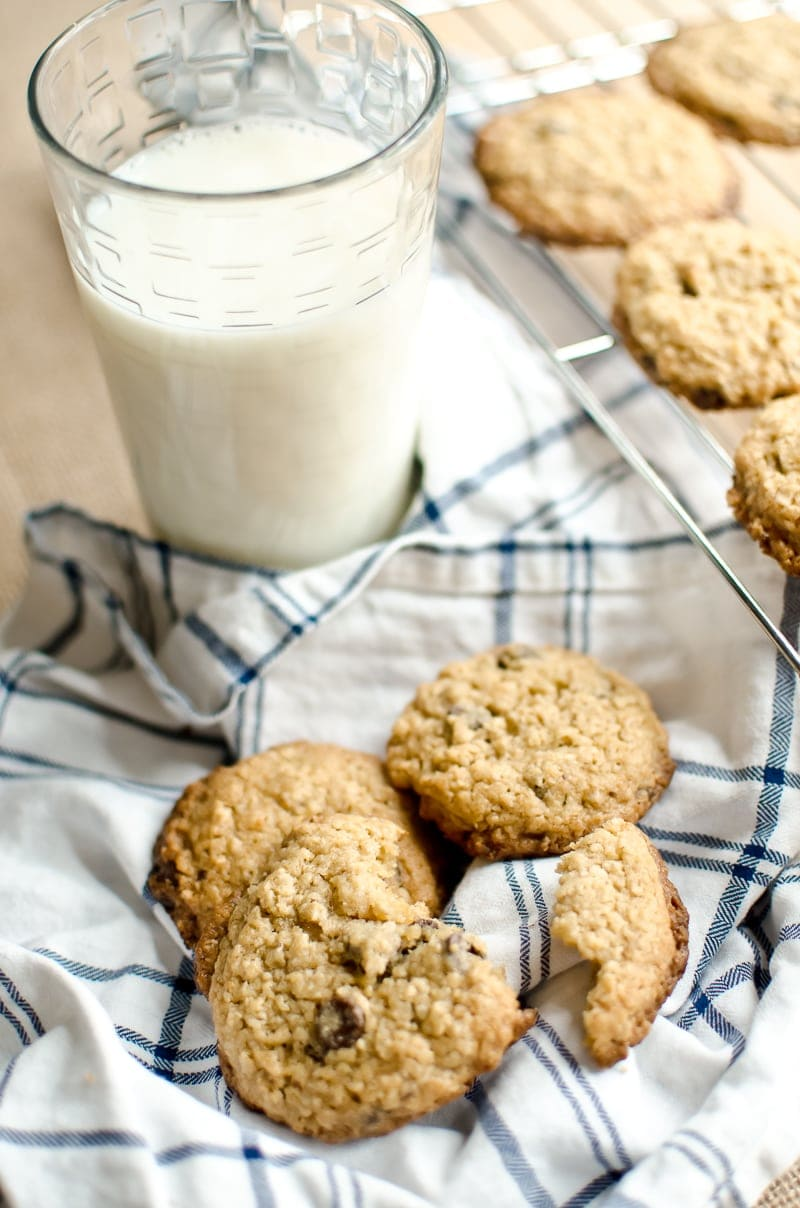 oatmeal chocolate chip cookies with a tall glass of milk