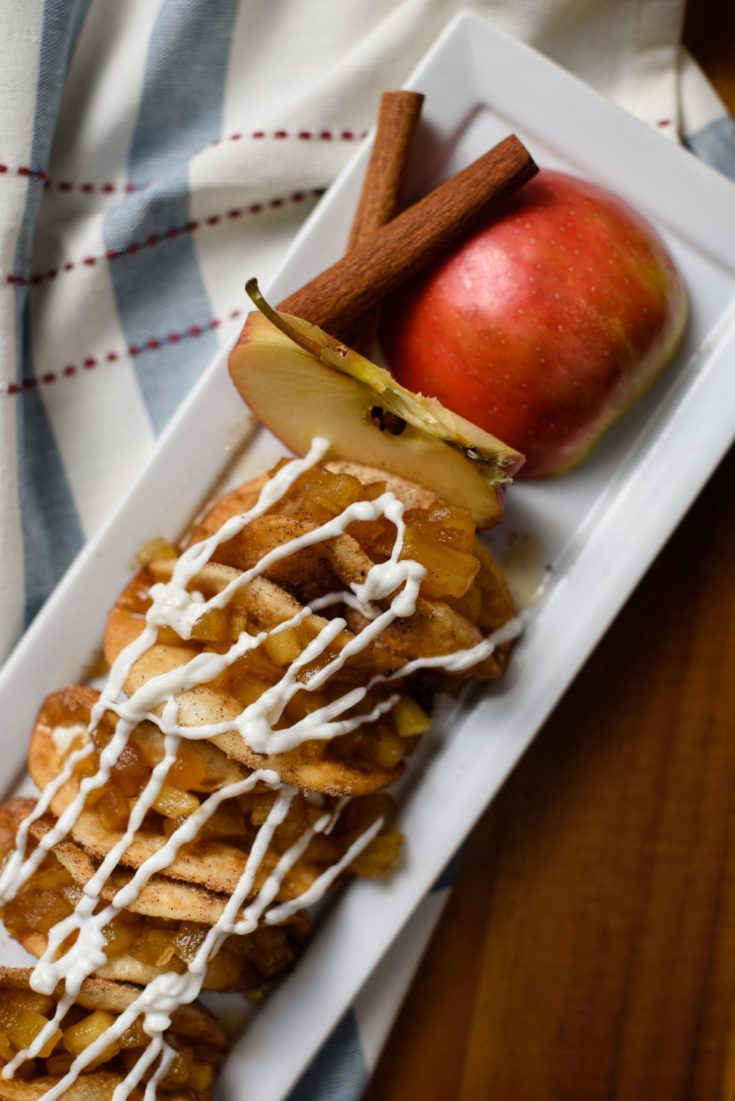 A fun twist on traditional apple pie! These mini apple pie tacos takes a classic fall dessert into a portable bite!